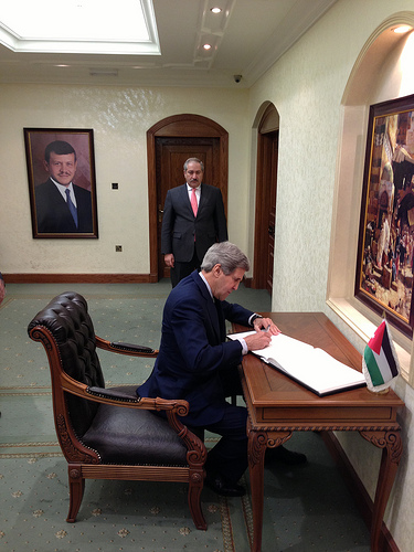 Secretary of State John Kerry signs the guest book at the Ministry of Foreign Affairs in Amman, Jordan on March 23, 2013